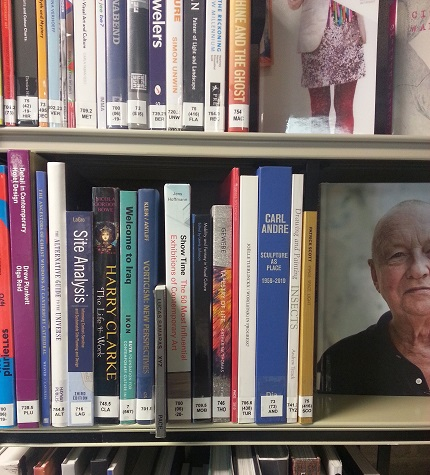 A library shelf with a selection of books