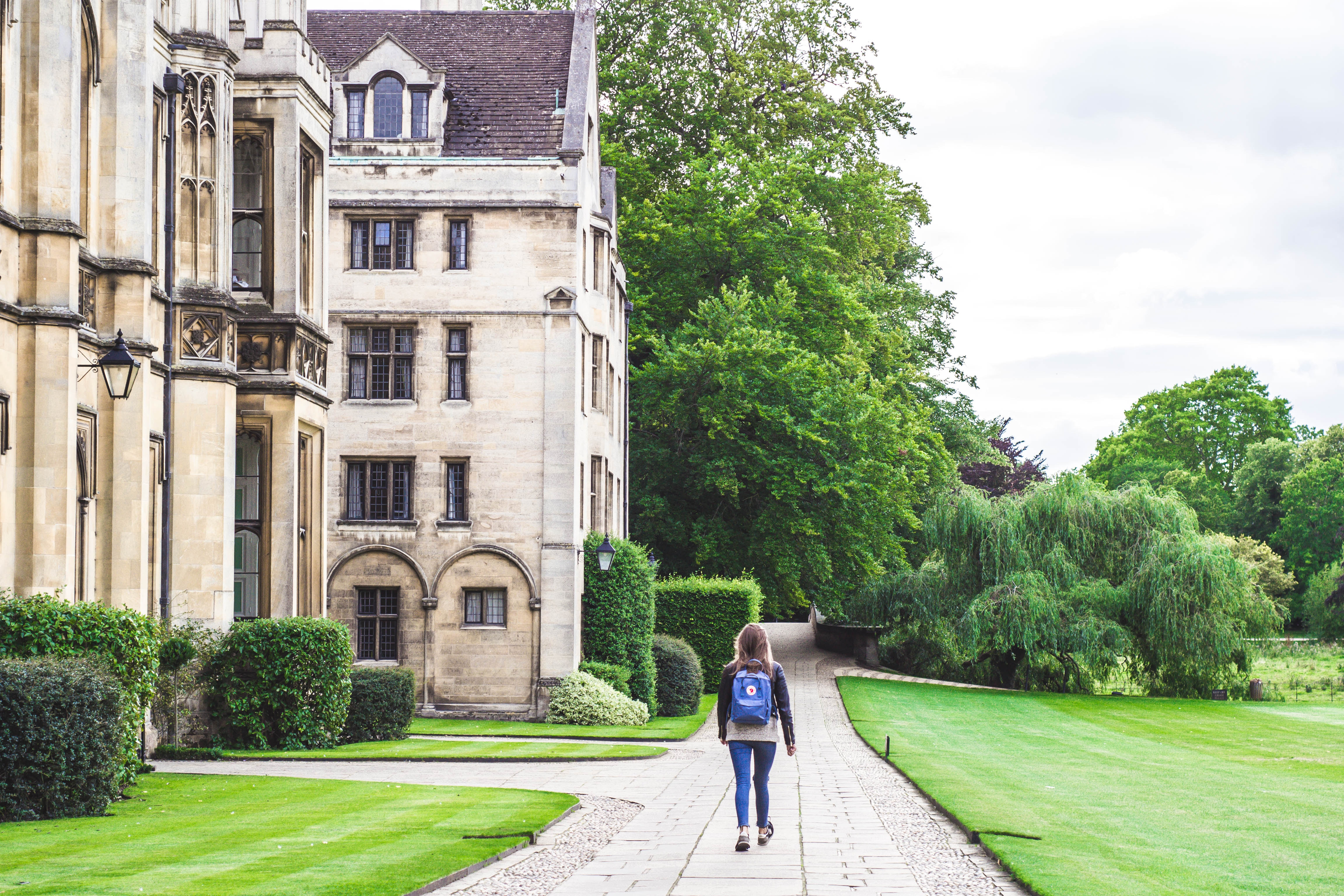 A student walks through the grounds at King's College