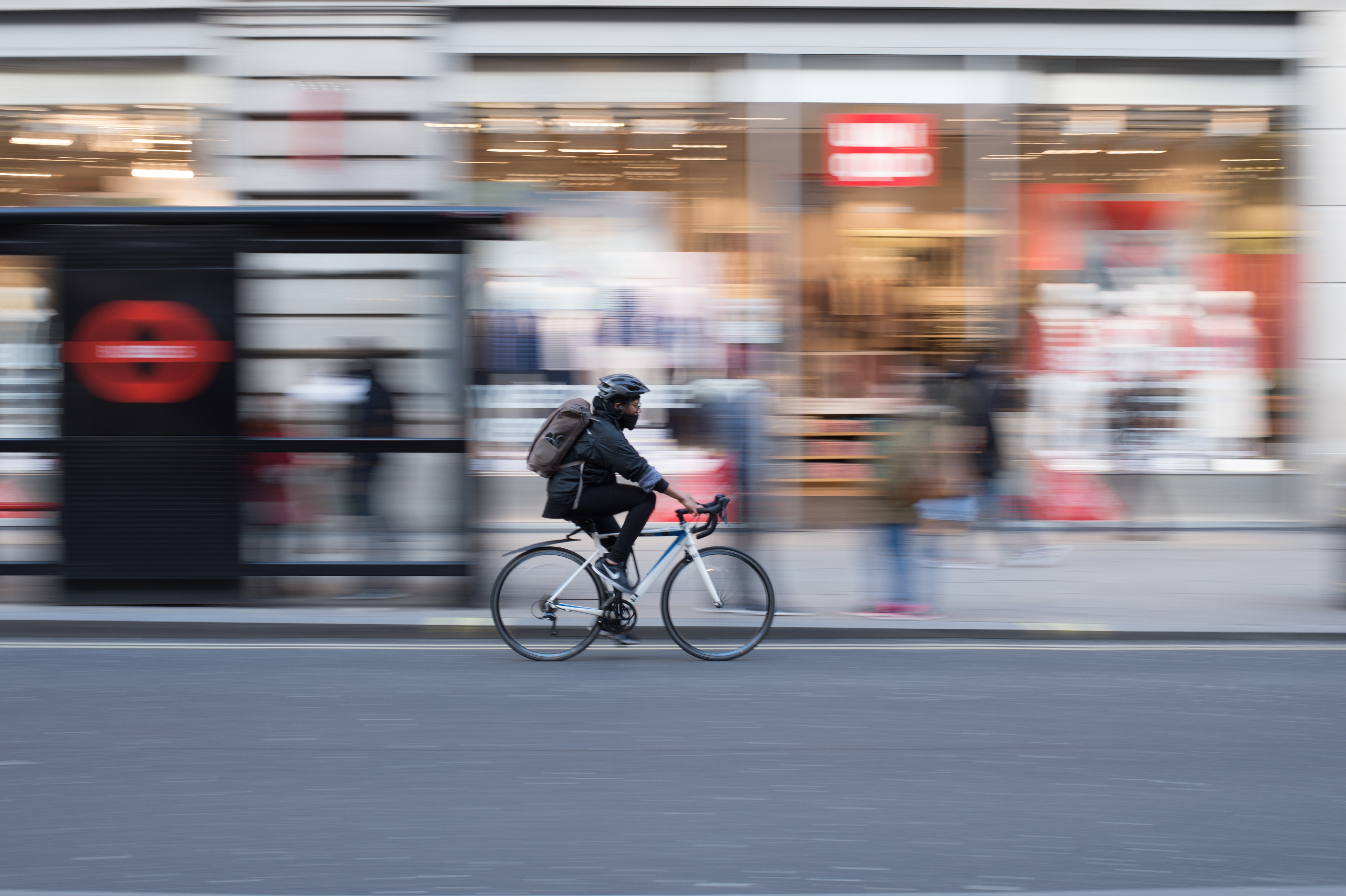 Decorative image of Person on bike cycling
