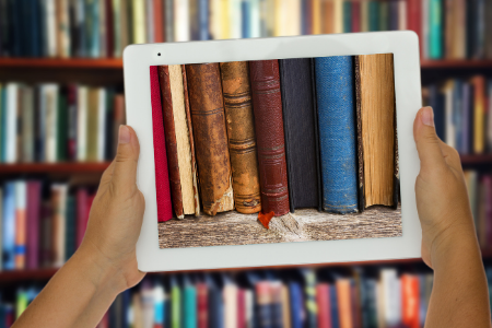 Tablet displaying image of books