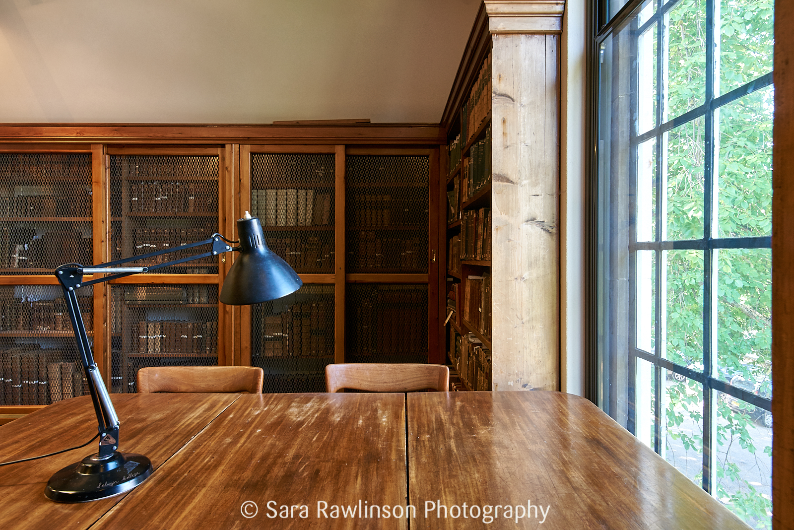 Desk, lamp, and window in Selwyn College Library