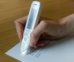 Photo of how to hold the C-Pen Reader above printed text at a 70 to 90 degree angle.