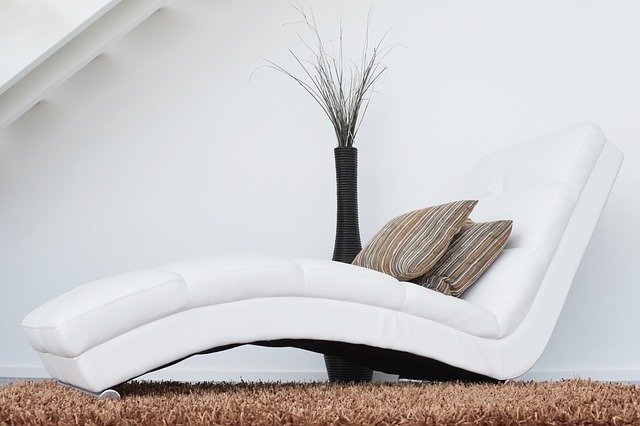White couch with brown cushions