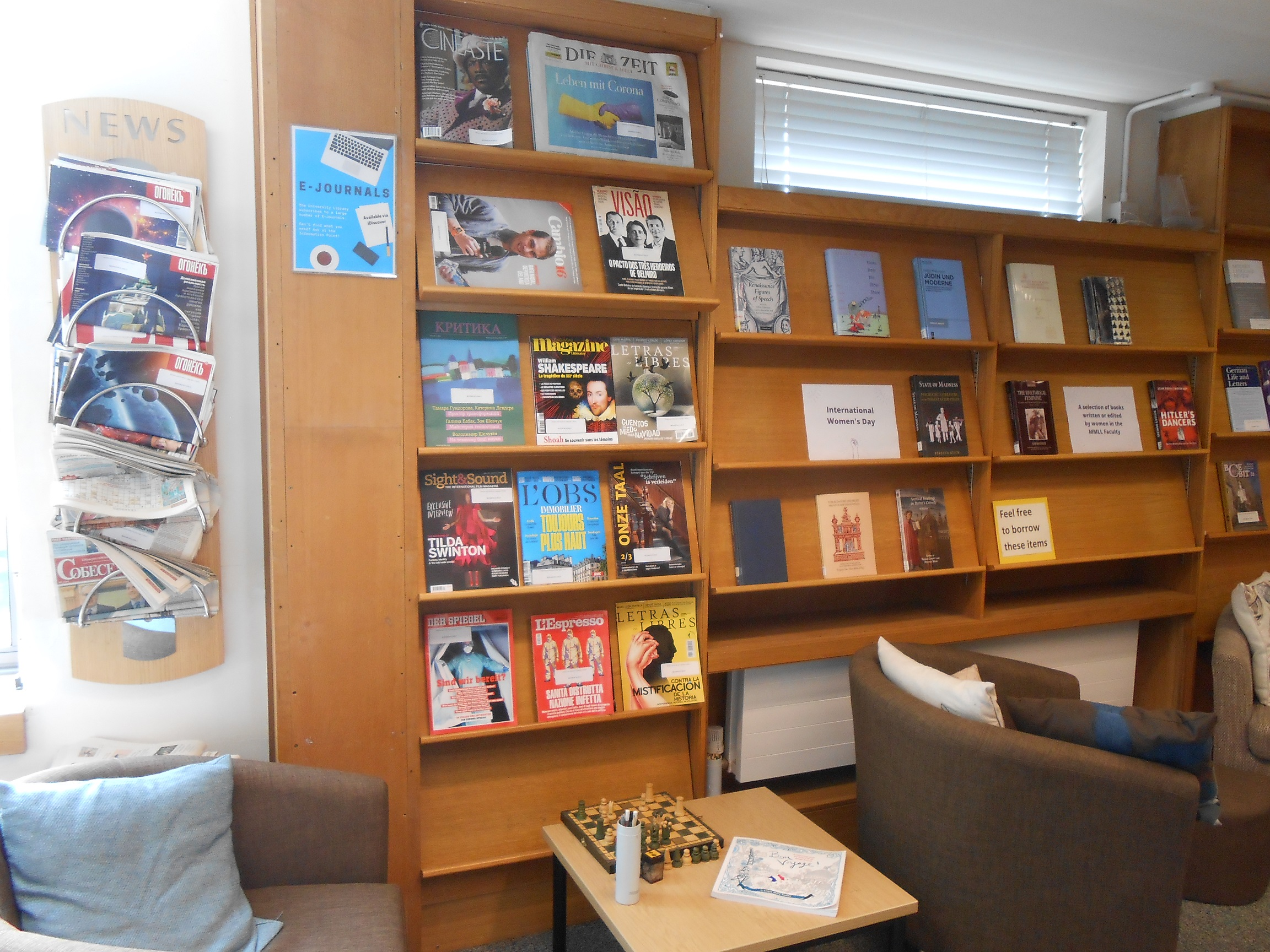 Colour photo of the MMLL Library lobby with a book exhibition