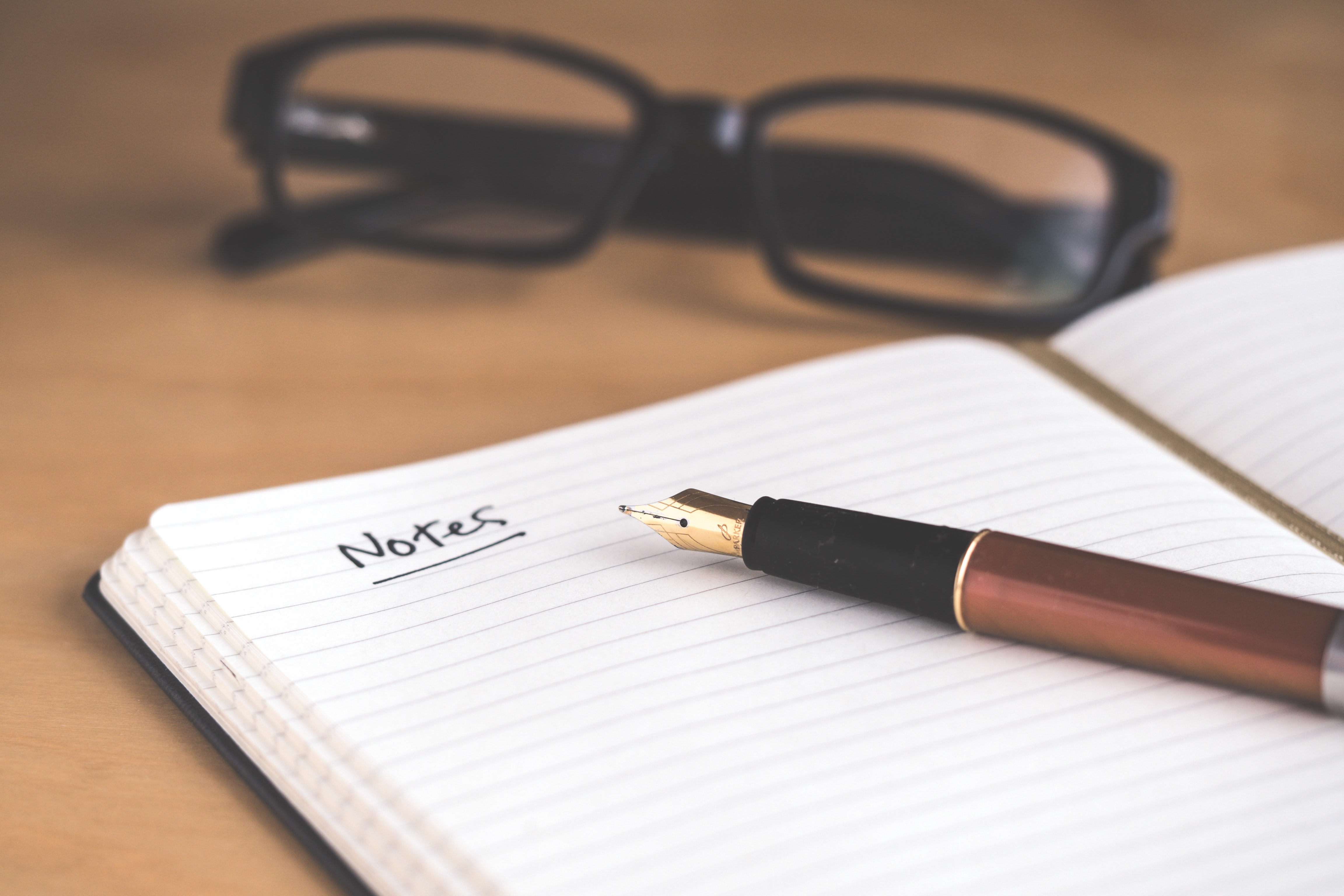 Picture of a pen and a notebook