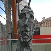 Close up of the head of George Fullard's Walking Man.