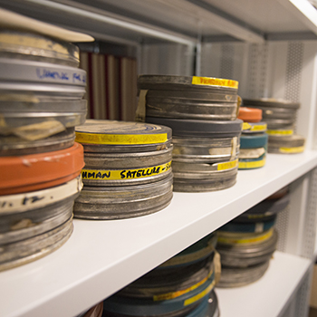 Film cannisters on a shelf.