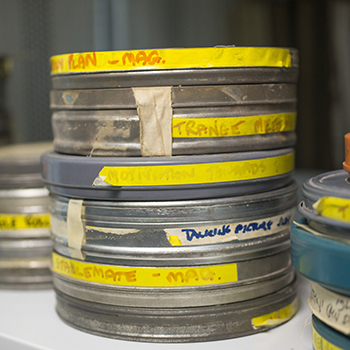 Photograph of film cannisters on a shelf