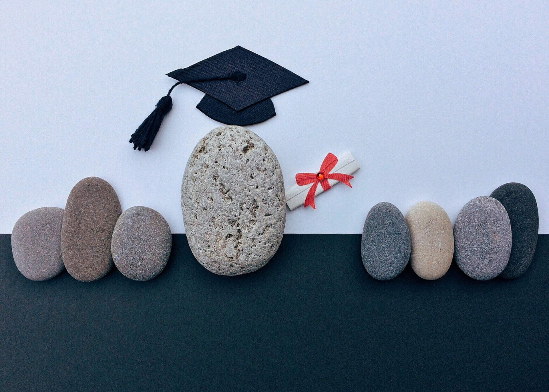Stone picture depicting graduation ceremony