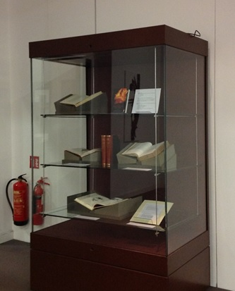 Tall exhibition case with examples of items within.