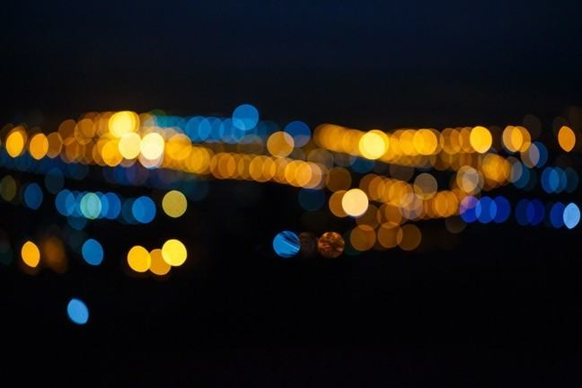 The distant, out-of-focus lights of a city