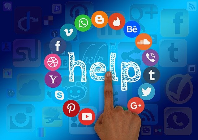 finger pointing to digital and social media icons
