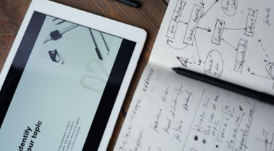 notebook with pen and tablet device