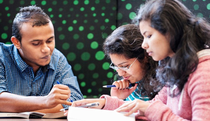 group of 3 students studying together