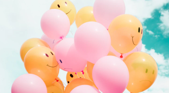Bunch of balloons with happy and sad faces