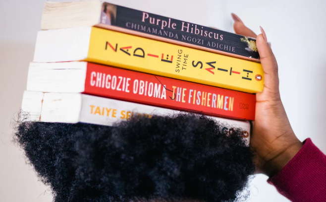 Books balanced on someone's head