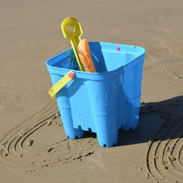 Bucket and spade on a sandy beach