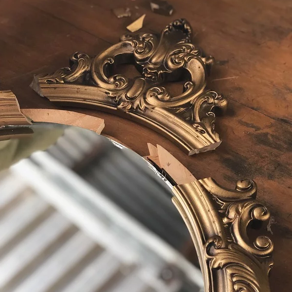 Antique mirror with broken frame
