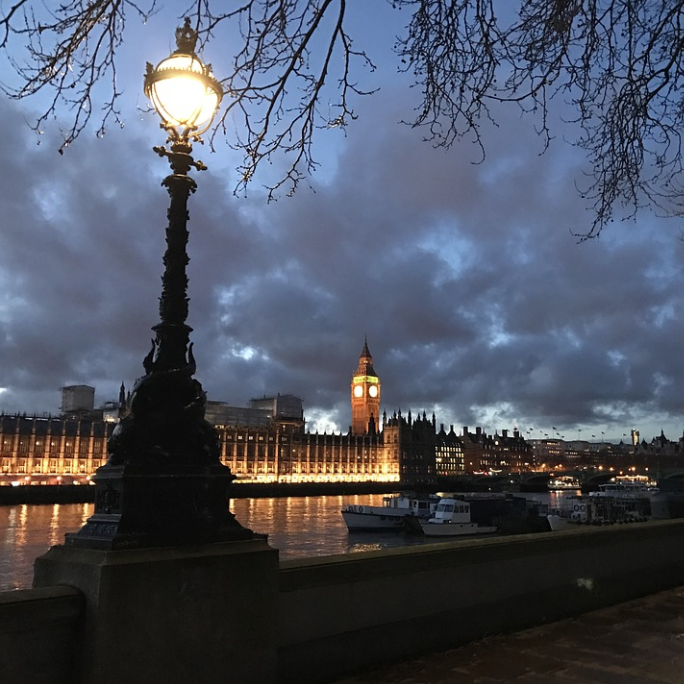 Palace of Westminster with dark clouds looming