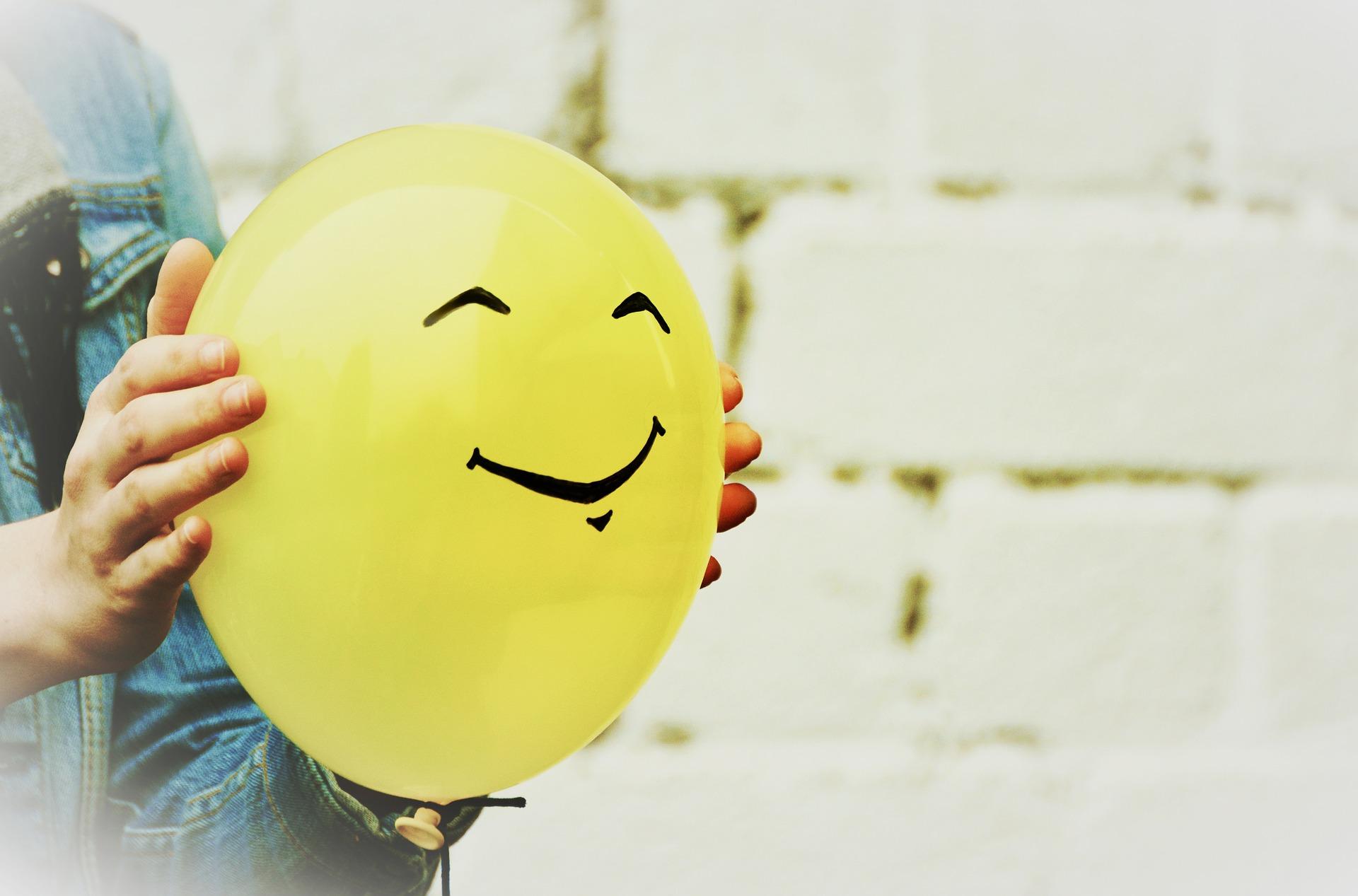 A yellow balloon with a smiley face
