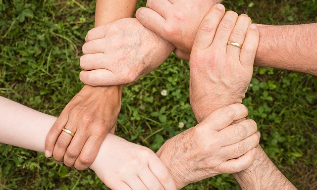 Photo of 6 linked hands