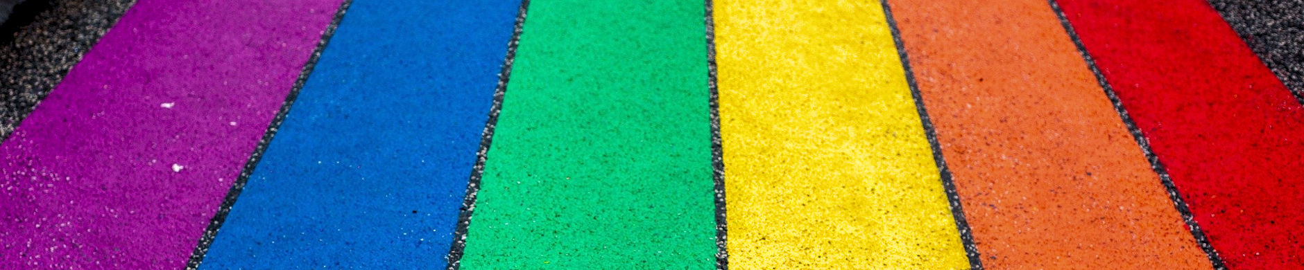 Rainbow pride colours painted on a pavement