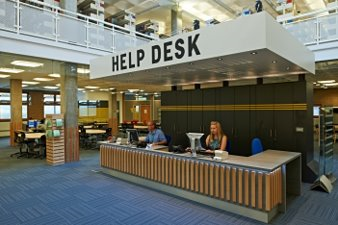 Photo of the library helpdesk before building work