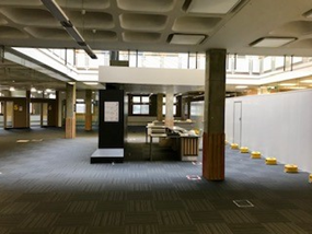 Photo of the library helpdesk with hoardings up