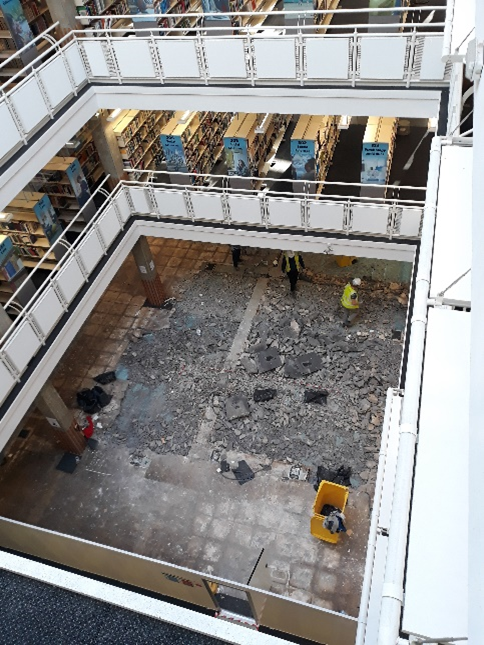 Photo of the library with helpdesk removed from the third floor