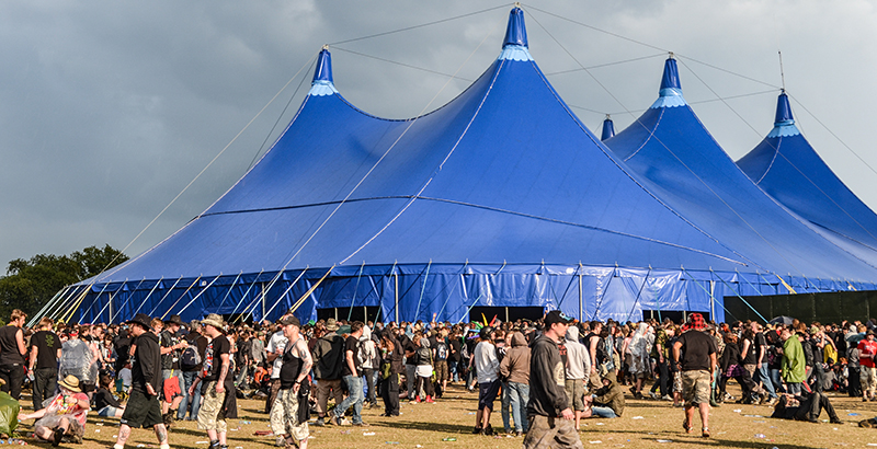 Festival crowds in front of a blue tent