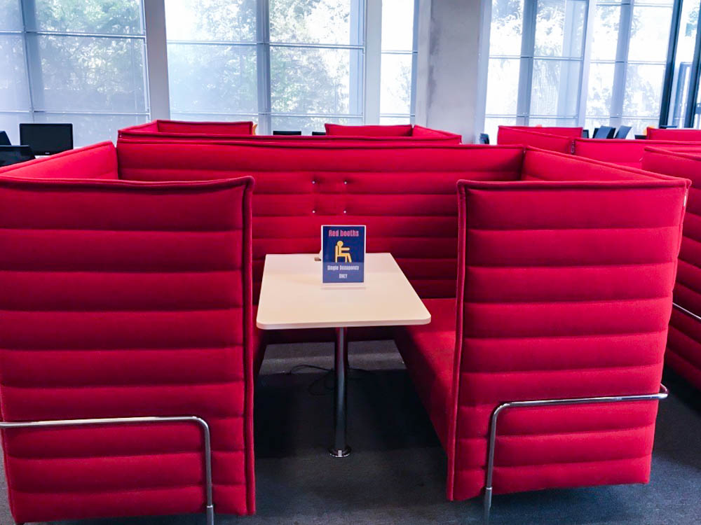 Red study booth in Stockwell Street library with single occupancy signage