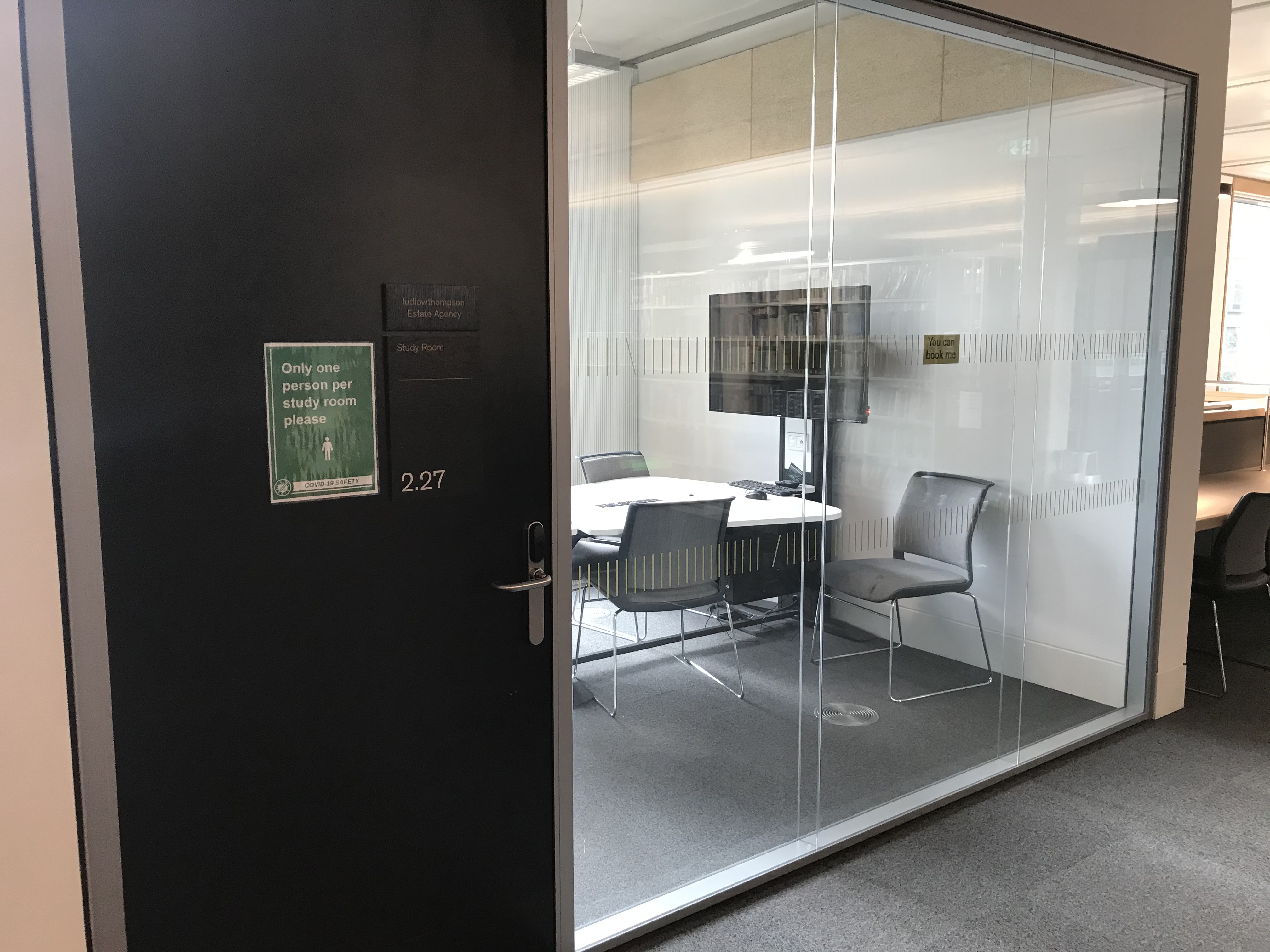 study room with green sign indicating one person use only