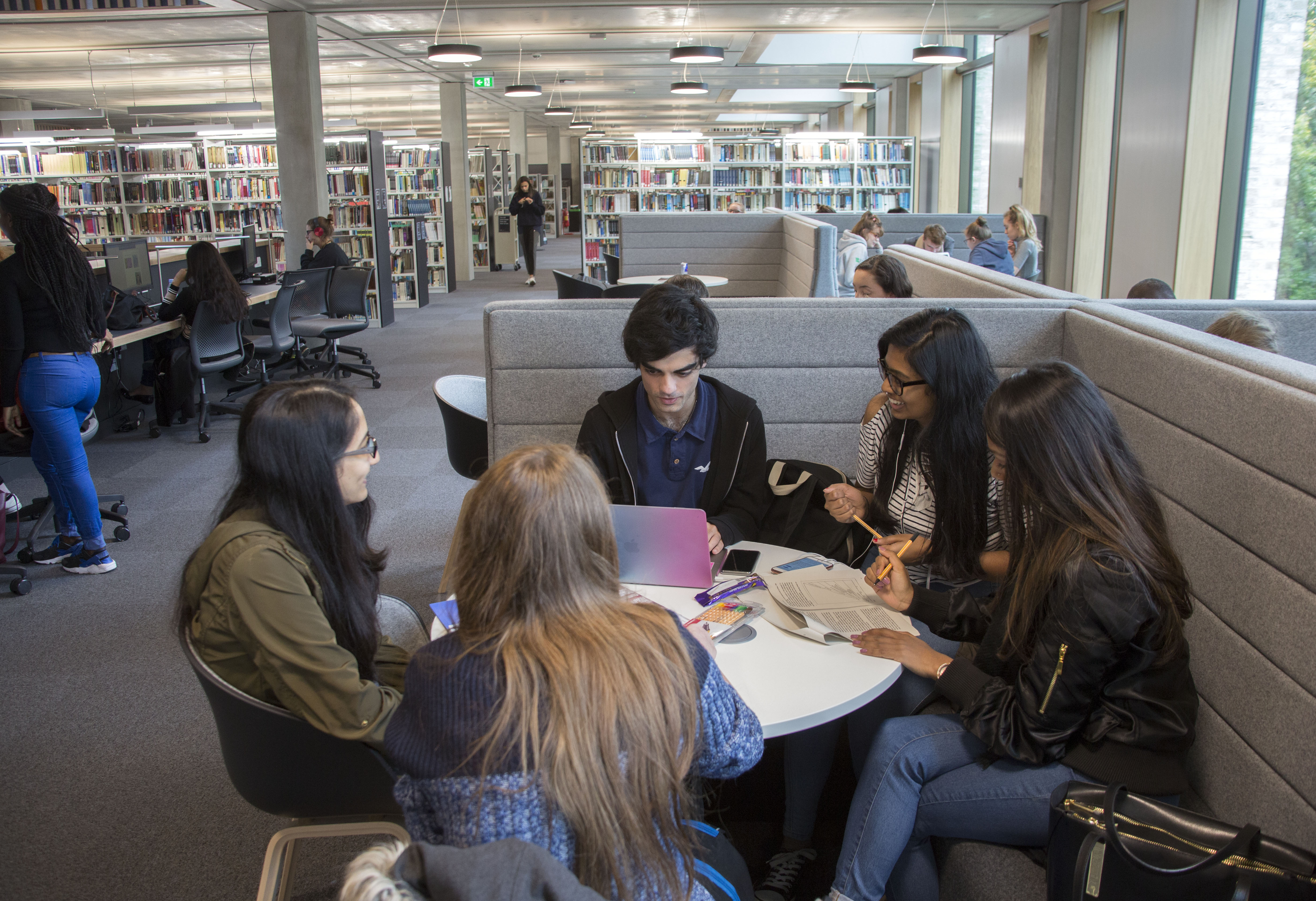 A group of students studying together on a busy First Floor