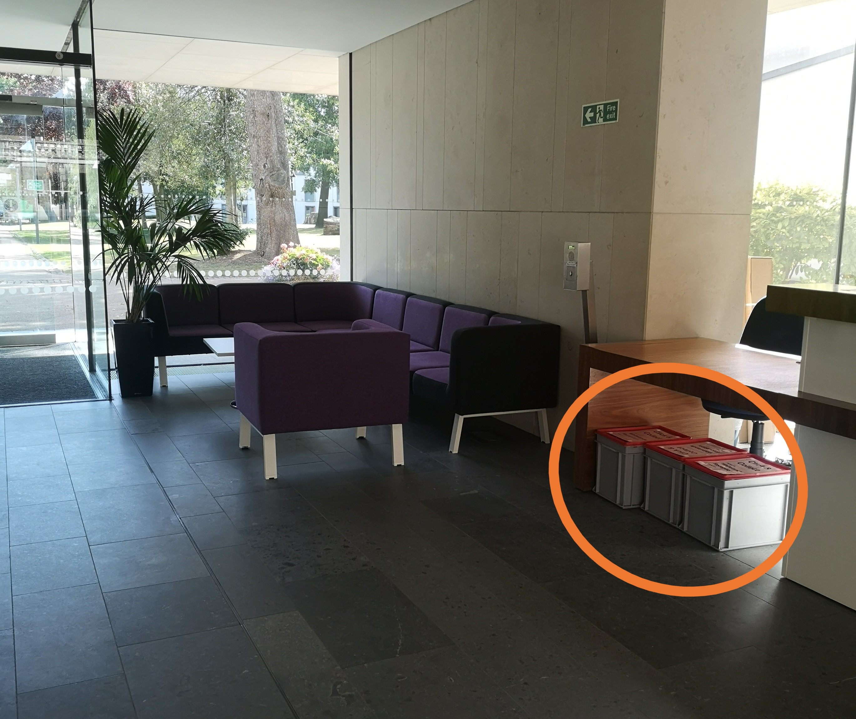 Click and Collect collection point located at the end of the reception desk closest to the entrance.