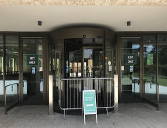 Main entrance of the library closed with a sign directing to rear Hirst-side entrance