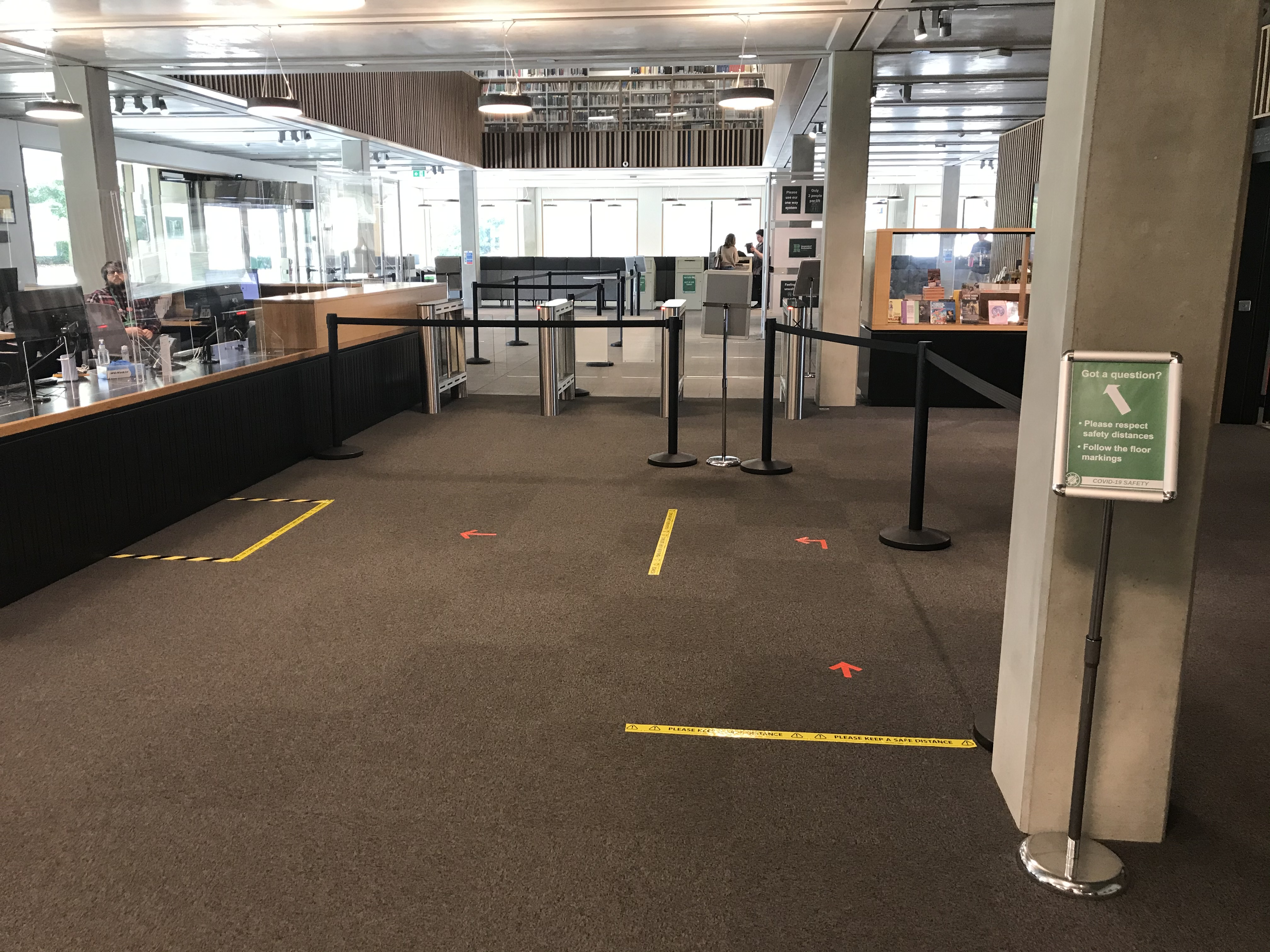 Taped sections of ground floor showing desk queue