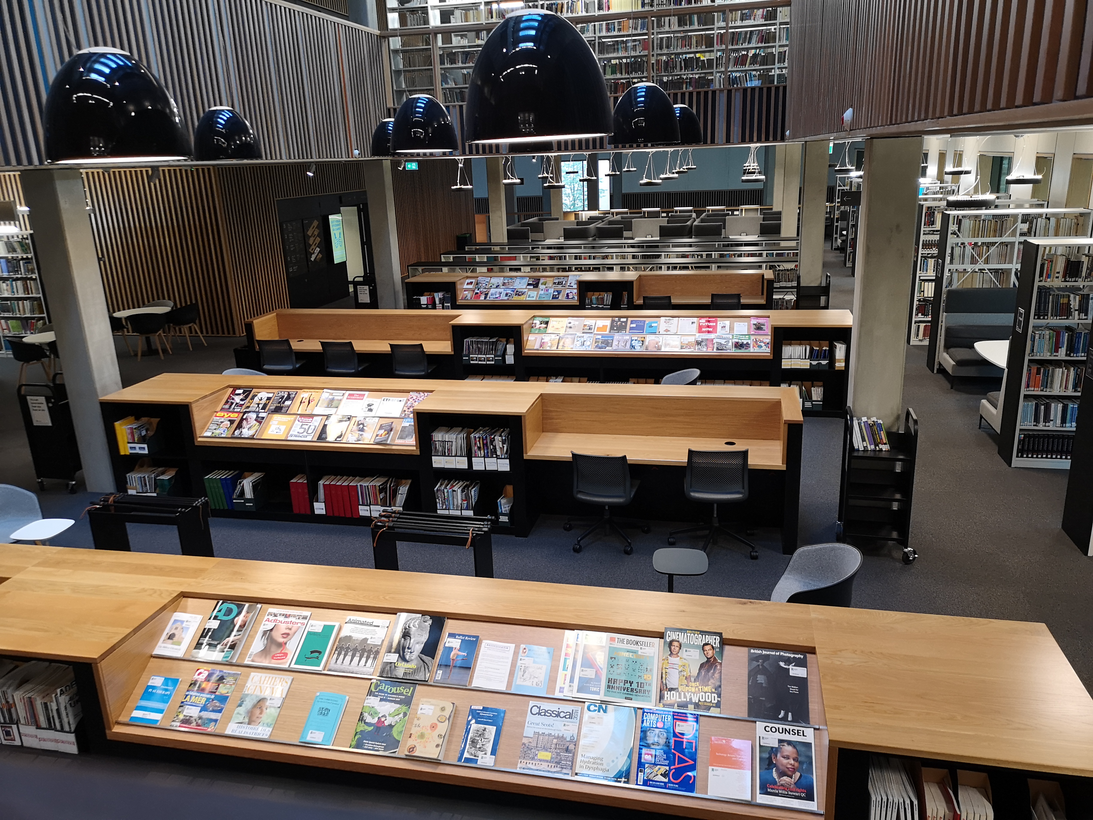 The ground floor from the central staircase - various study desks and bookshelves can be seen, as well as the journal area