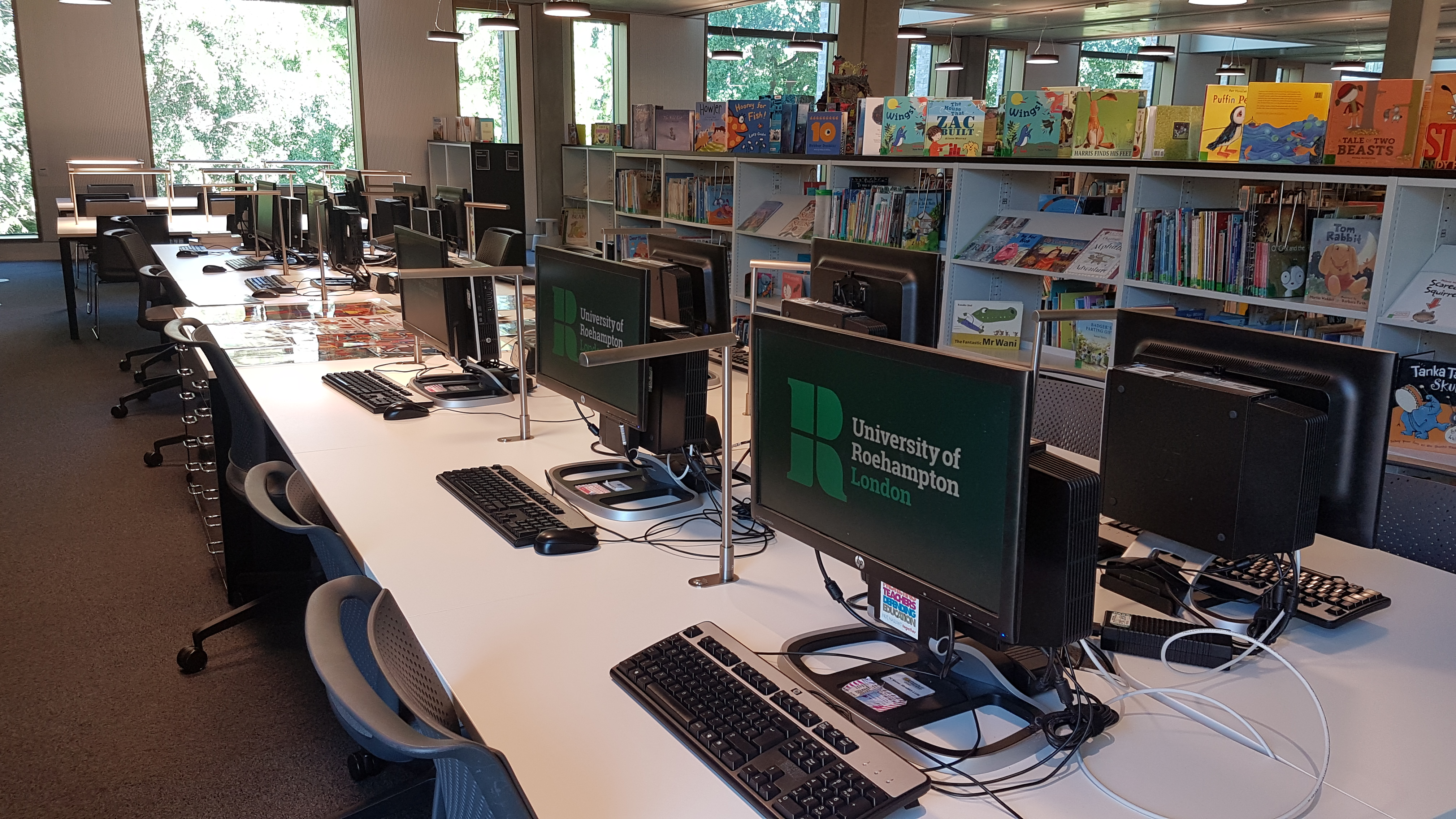 The school experience area from near the computers - the picture book collection, a number of PCs and some study tables to the left can be seen