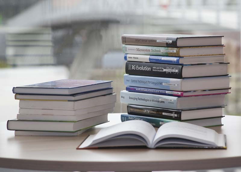 A pile of books on a desk
