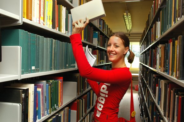 Student finding a book in the Library