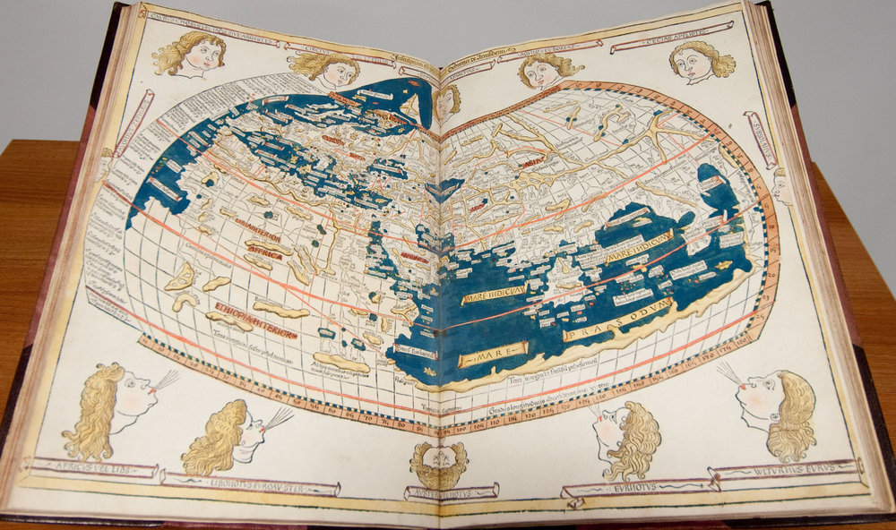 ' Ptolemy, Cosmographia: 1482' an image of an open book showing a map of the Earth as a sphere