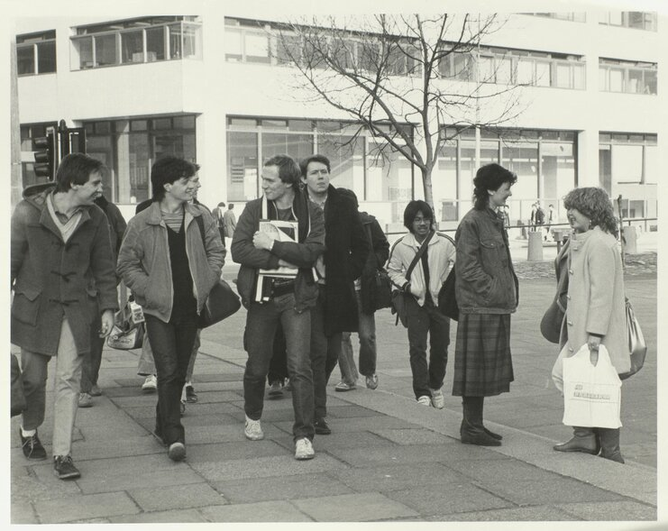 Members of the University walking through University Square at the junction of Brownlow Hill and Mount Pleasant, the Electrical Engineering Building visible in the background [1980s-1990s]