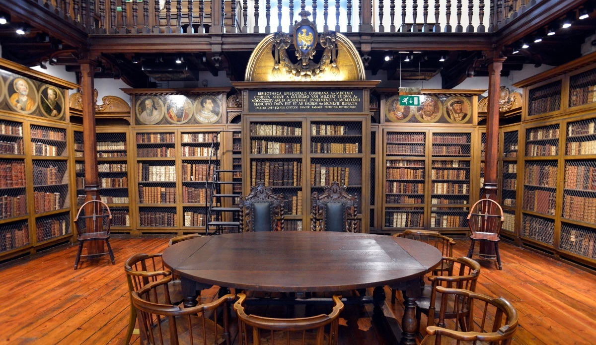 Bookshelves, table and chairs inside Cosin's Library