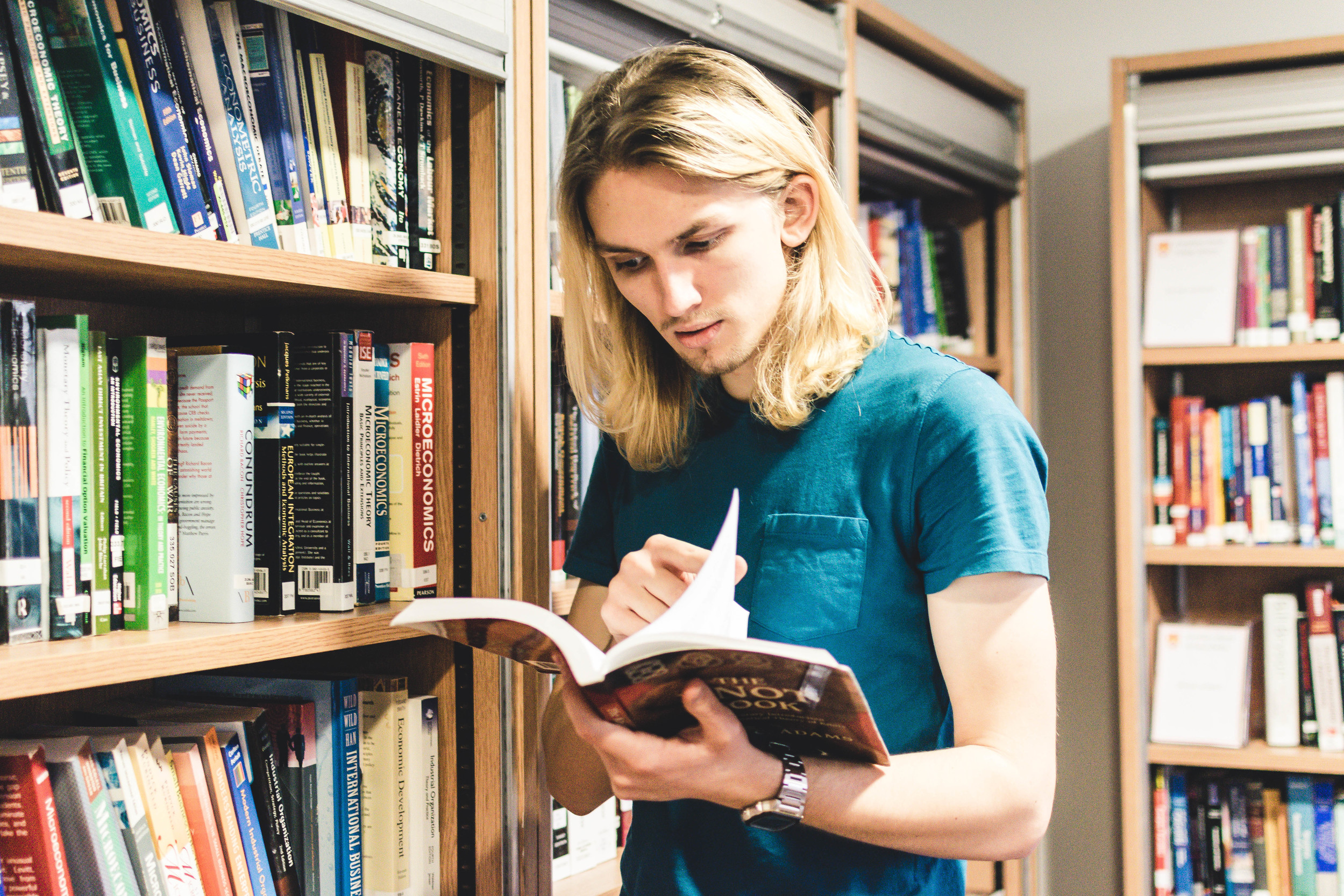 Student browsing books in Bill Bryson Library