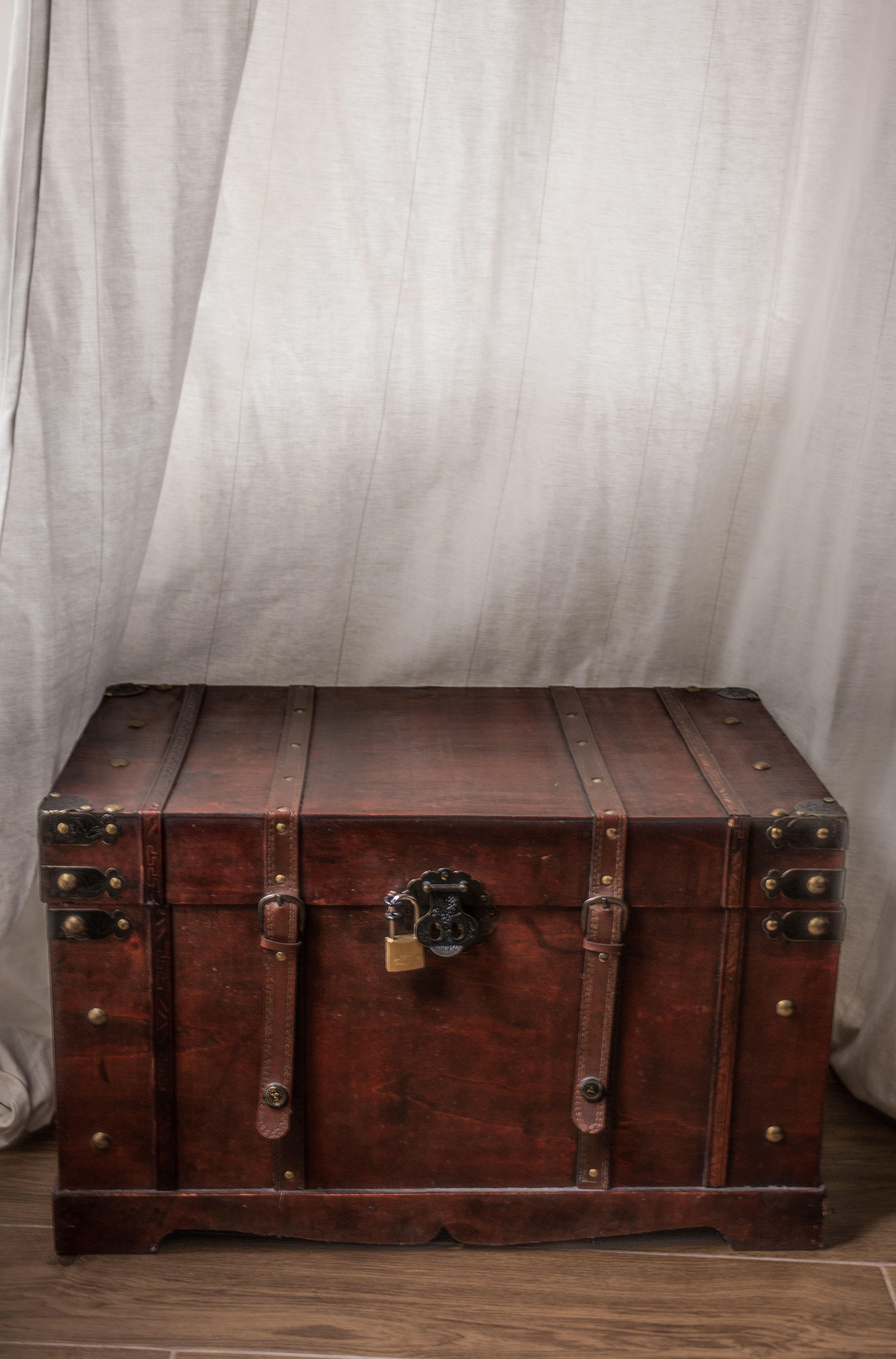 A travelling trunk, lid closed and locked with a padlock
