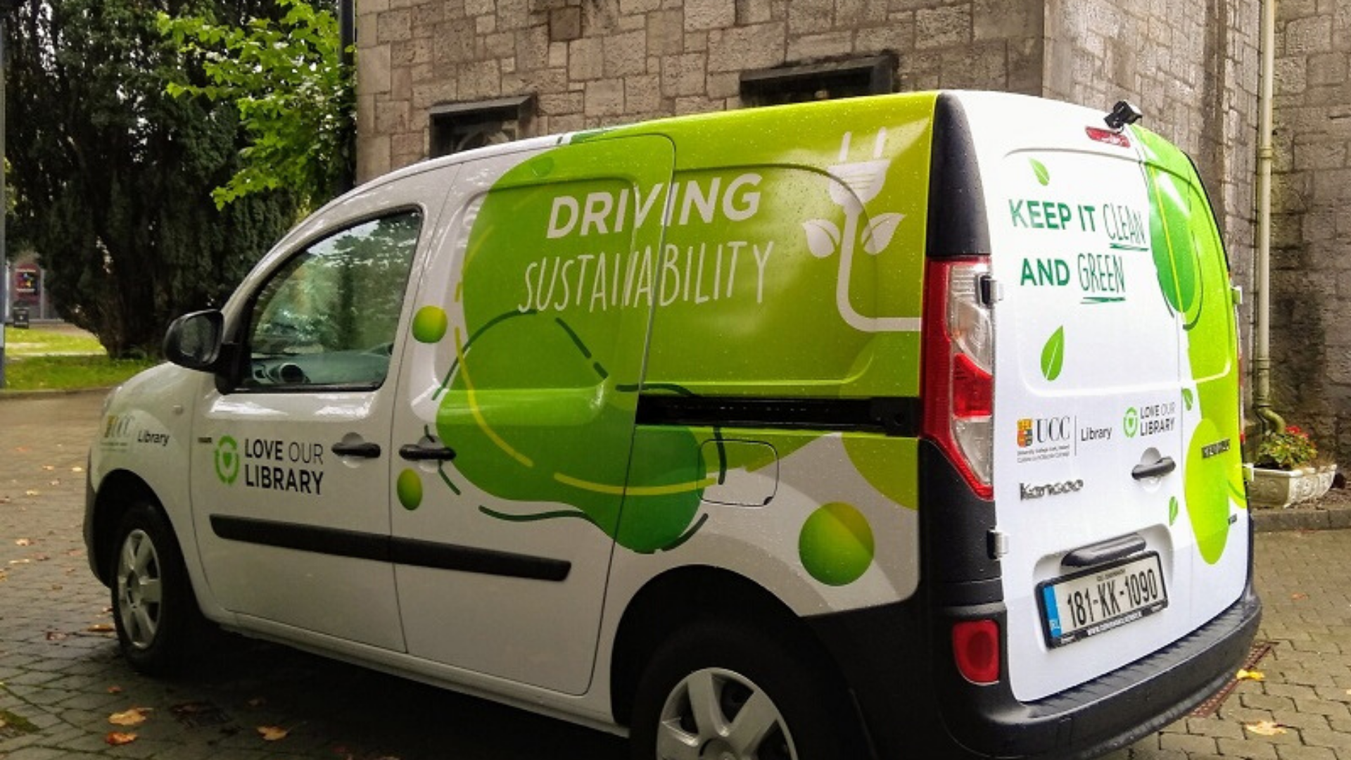 library van with green graphics and