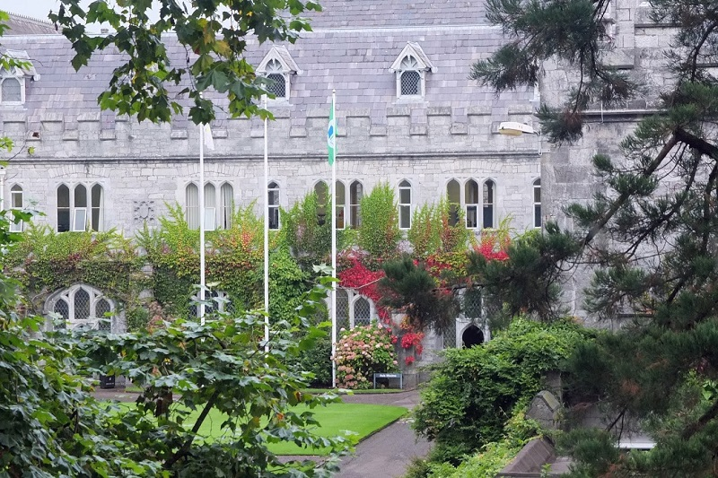 image of the quad in UCC with the green fkag flying
