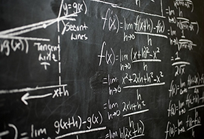 Blackboard with chalk equations.