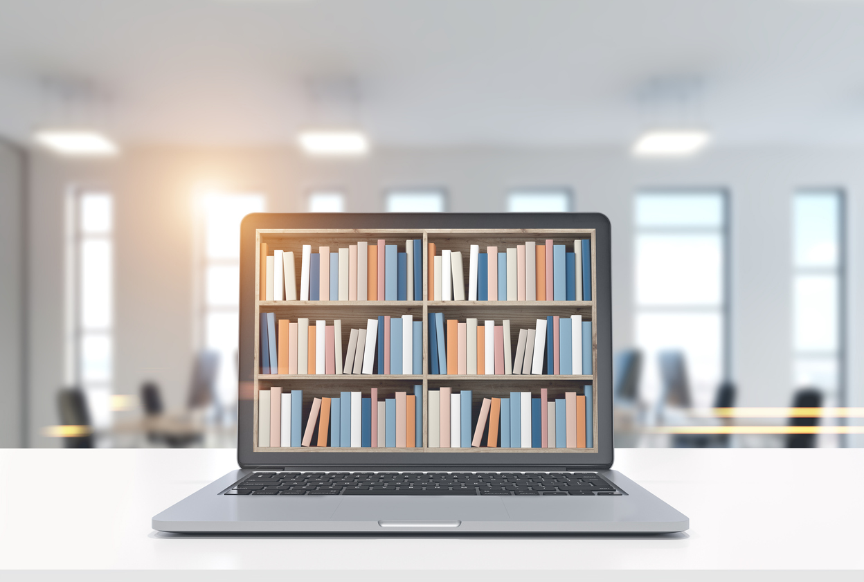 Image of a laptop with books on the laptop screen.
