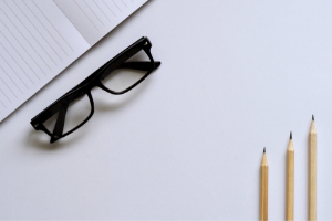 A top-down image of a notepad, glasses and three pencils on a desk. Click here to see the services we offer to part time students